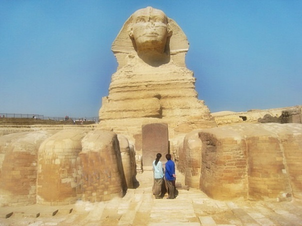 Tania and her mom at the feet of the Great Sphinx of Giza, Egypt