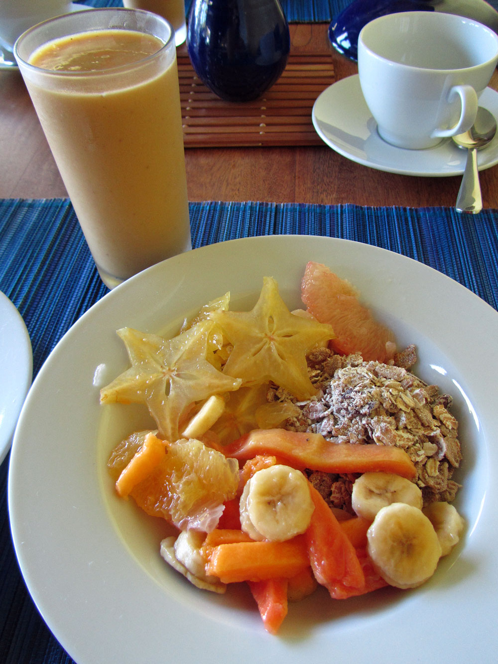 tropical fruit, granola and smoothie