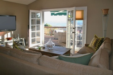 family room leading to rear deck and fantastic view