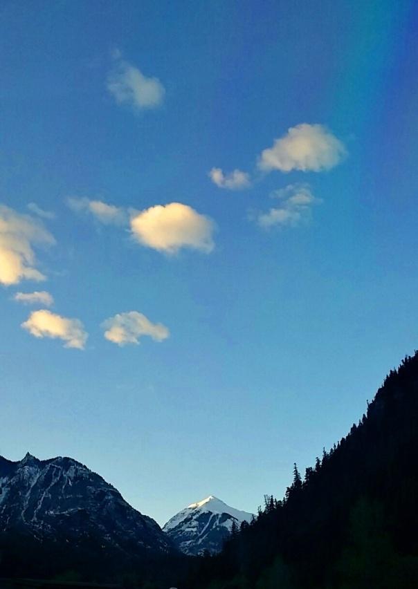 sun clouds peak